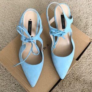 Baby blue suede pumps